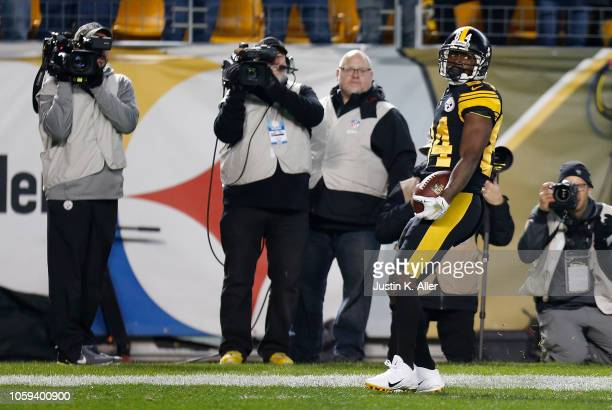 Antonio Brown of the Pittsburgh Steelers celebrates after a 52 yard touchdown reception during the second quarter in the game at Heinz Field on...