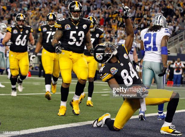Antonio Brown of the Pittsburgh Steelers celebrates after scoring a touchdown against Mike Jenkins of the Dallas Cowboys at Cowboys Stadium on...