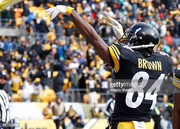 Antonio Brown of the Pittsburgh Steelers celebrates after scoring a touchdown during the first quarter against the Miami Dolphins in the AFC Wild...