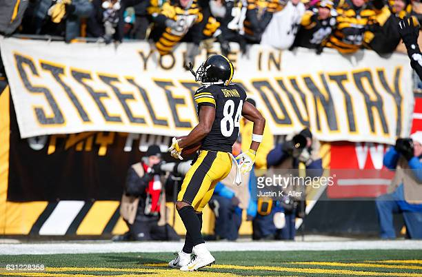 Antonio Brown of the Pittsburgh Steelers celebrates after scoring a touchdown in the first quarter during the Wild Card Playoff game against the...