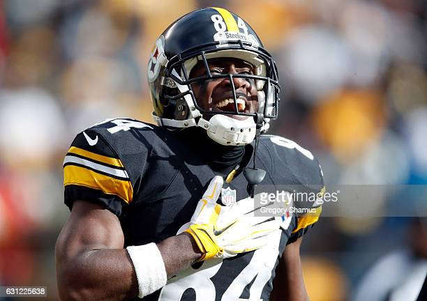 Antonio Brown of the Pittsburgh Steelers celebrates after scoring his second touchdown during the first quarter against the Miami Dolphins in the AFC...