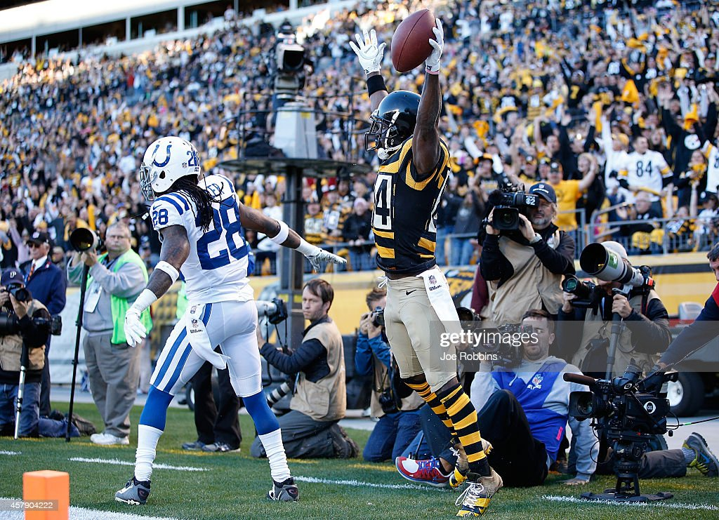 Antonio Brown #84 of the Pittsburgh Steelers celebrates his touchdown catch in front of Greg Toler #28 of the Indianapolis Colts during the second quarter at Heinz Field on October 26, 2014 in Pittsburgh, Pennsylvania.