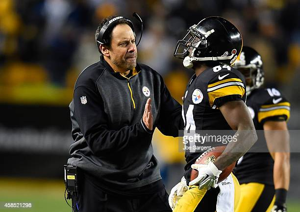 Antonio Brown of the Pittsburgh Steelers celebrates his touchdown with offensive coordinator Todd Haley during the game against the Baltimore Ravens...