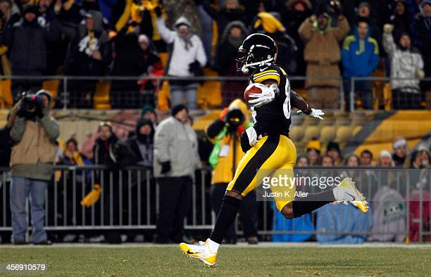 Antonio Brown of the Pittsburgh Steelers celebrates while scoring on a 67 yard punt return against the Cincinnati Bengals during the game on December...