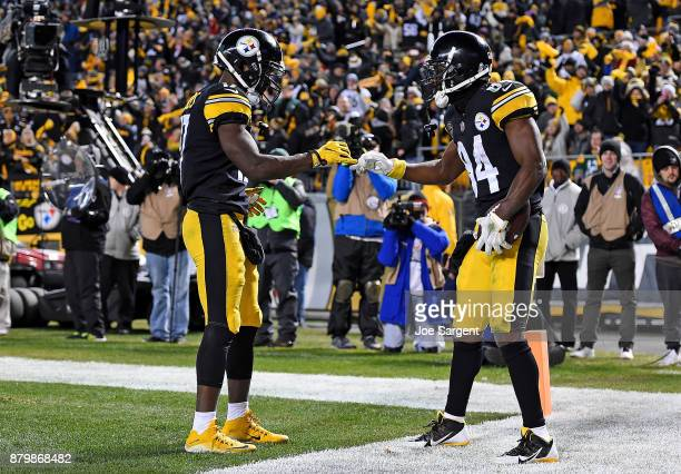 Antonio Brown of the Pittsburgh Steelers celebrates with Eli Rogers after a 1 yard touchdown reception in the third quarter during the game against...