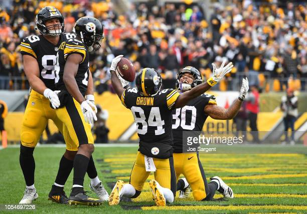 Antonio Brown of the Pittsburgh Steelers celebrates with James Conner after a 1 yard touchdown reception during the second quarter in the game...