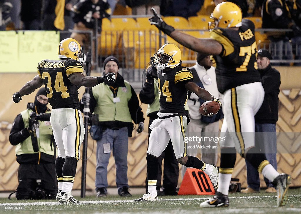 Antonio Brown #84 of the Pittsburgh Steelers celebrates with teammate Rashard Mendenhall #34 after scoring on a 79 yard touchdown pass against the Cleveland Browns during the game on December 8, 2011 at Heinz Field in Pittsburgh, Pennsylvania.
