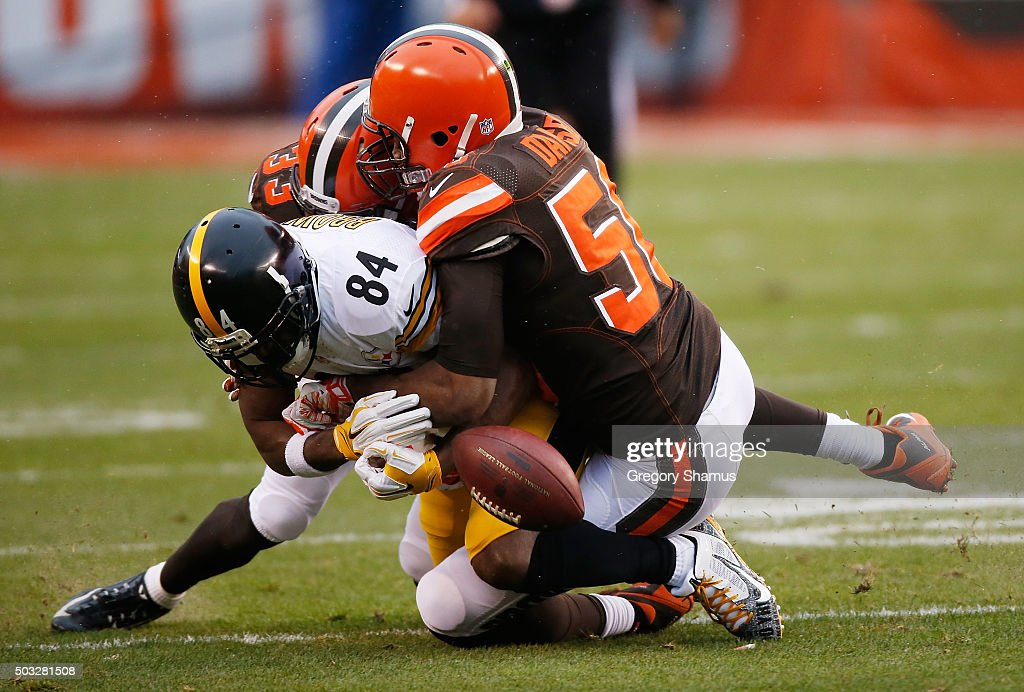 Antonio Brown #84 of the Pittsburgh Steelers fumbles the ball after being his by Karlos Dansby #56 of the Cleveland Browns during the first quarter at FirstEnergy Stadium on January 3, 2016 in Cleveland, Ohio.