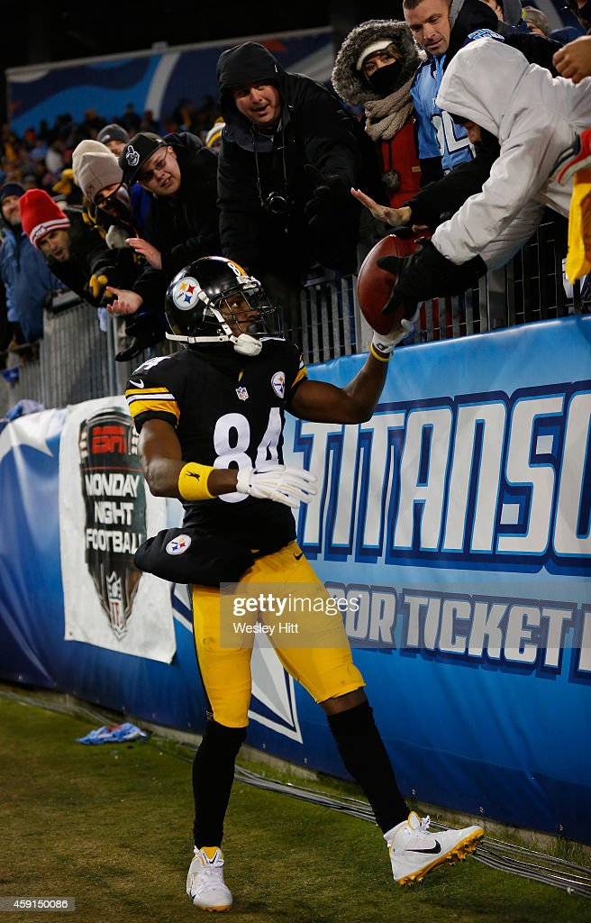 Antonio Brown #84 of the Pittsburgh Steelers gives the ball to a fan in celebration of his touchdown against the Tennessee Titans in the fourth quarter of the game at LP Field on November 17, 2014 in Nashville, Tennessee. The Pittsburgh Steelers won 27-24.