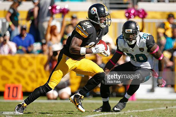 Antonio Brown of the Pittsburgh Steelers is defended by Craig Loston of the Jacksonville Jaguars during the second half of the game at EverBank Field...