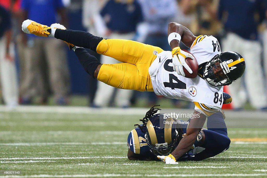 Antonio Brown #84 of the Pittsburgh Steelers is tackled by Janoris Jenkins #21 of the St. Louis Rams after making a catch in the first quarter at the Edward Jones Dome on September 27, 2015 in St. Louis, Missouri.