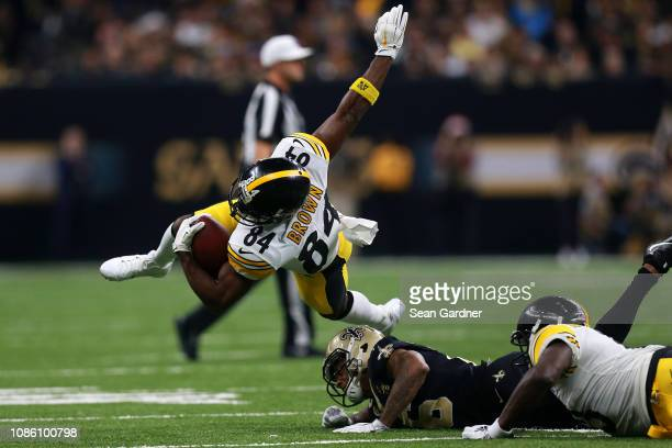 Antonio Brown of the Pittsburgh Steelers is tackled by Marcus Williams of the New Orleans Saints during the first half at the MercedesBenz Superdome...
