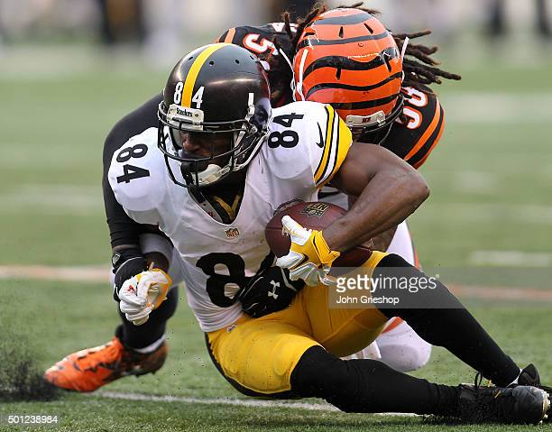 Antonio Brown of the Pittsburgh Steelers is tackled by Rey Maualuga of the Cincinnati Bengals during the third quarter at Paul Brown Stadium on...