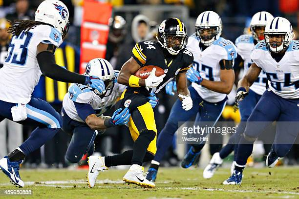 Antonio Brown of the Pittsburgh Steelers is tackled in the second quarter by George Wilson of the Tennessee Titans at LP Field on November 17 2014 in...