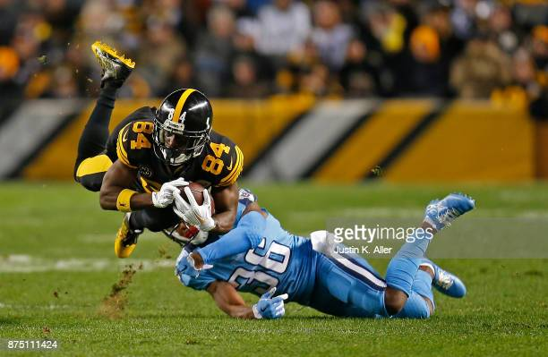Antonio Brown of the Pittsburgh Steelers is tripped up for a tackle by LeShaun Sims of the Tennessee Titans in the first quarter during the game at...