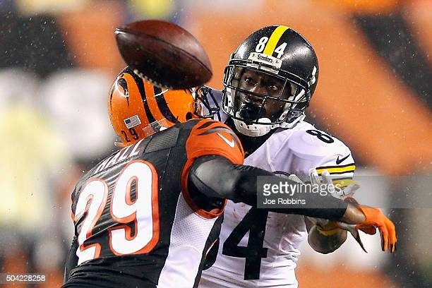 Antonio Brown of the Pittsburgh Steelers is unable to catch a pass as he is defended by Leon Hall of the Cincinnati Bengals in the fourth quarter...