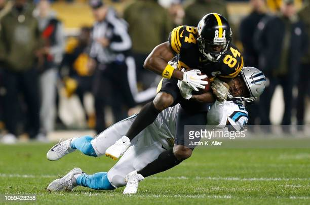 Antonio Brown of the Pittsburgh Steelers is wrapped up for a tackle by Mike Adams of the Carolina Panthers during the first half in the game at Heinz...
