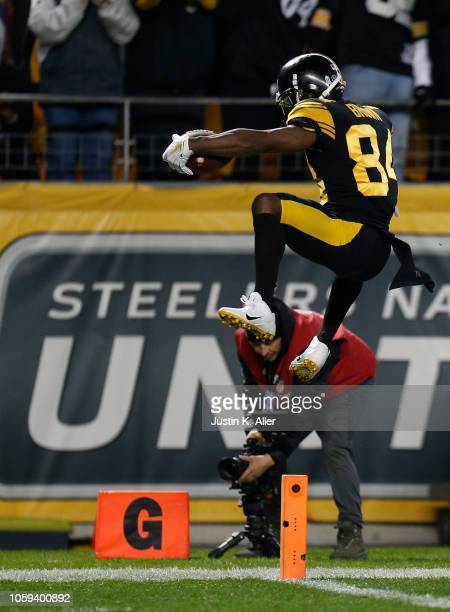 Antonio Brown of the Pittsburgh Steelers jumps into the end zone for a 53 yard touchdown reception during the second quarter in the game against the...