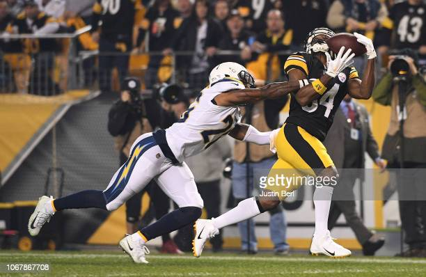 Antonio Brown of the Pittsburgh Steelers makes a catch against Casey Hayward of the Los Angeles Chargers for a 46 yard reception in the first quarter...