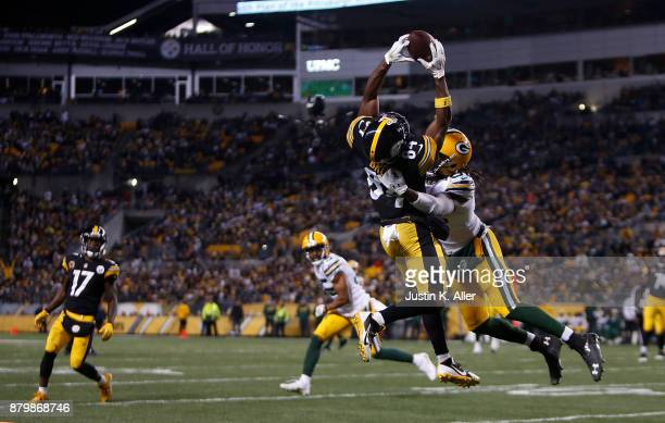 Antonio Brown of the Pittsburgh Steelers makes a catch as Davon House of the Green Bay Packers defends in the second half during the game at Heinz...