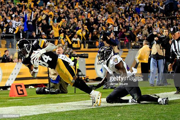 Antonio Brown of the Pittsburgh Steelers makes a catch but is ruled out of bounds as Darian Stewart of the Baltimore Ravens defends in the second...