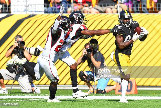 Antonio Brown of the Pittsburgh Steelers makes a catch for a 47 yard touchdown reception in front of Damontae Kazee of the Atlanta Falcons and Robert...