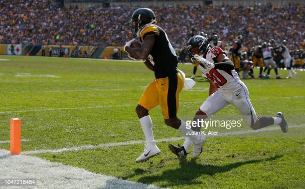 Antonio Brown of the Pittsburgh Steelers makes a catch for a 9 yard touchdown reception in the second half during the game against the Atlanta...