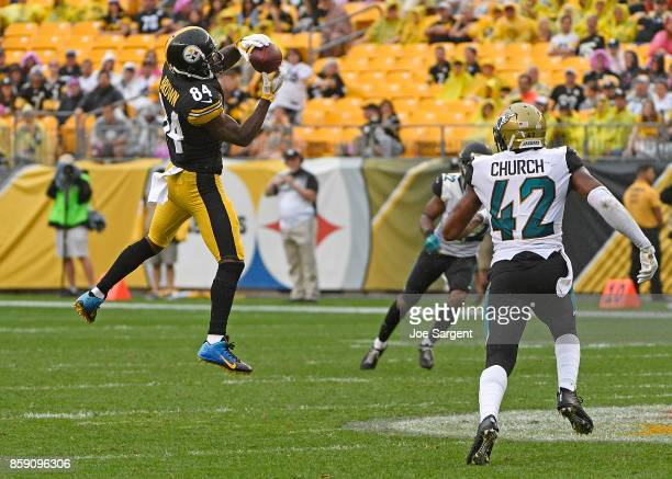 Antonio Brown of the Pittsburgh Steelers makes a catch in front of Barry Church of the Jacksonville Jaguars in the fourth quarter during the game at...