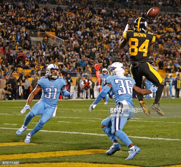 Antonio Brown of the Pittsburgh Steelers makes a catch in front of LeShaun Sims of the Tennessee Titans and Kevin Byard for a 41 yard touchdown...