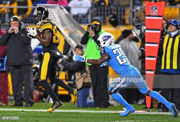 Antonio Brown of the Pittsburgh Steelers makes a catch in front of Adoree' Jackson of the Tennessee Titans in the first quarter during the game at...
