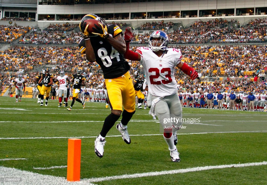 Antonio Brown #84 of the Pittsburgh Steelers makes a catch in the end zone that was over turned as a touchdown in the first half against Corey Webster #23 of the New York Giants during the game on August 10, 2013 at Heinz Field in Pittsburgh, Pennsylvania.