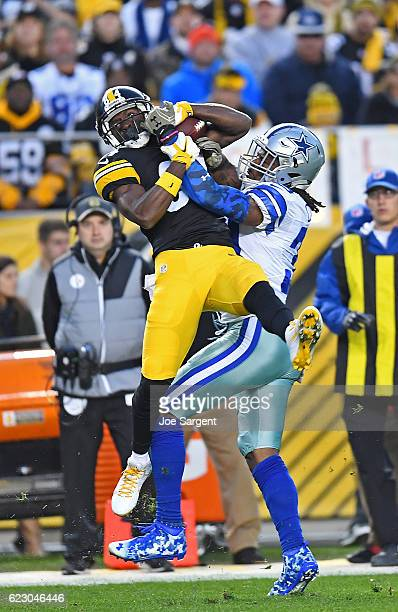 Antonio Brown of the Pittsburgh Steelers makes a catch while being defended by Brandon Carr of the Dallas Cowboys in the second quarter during the...