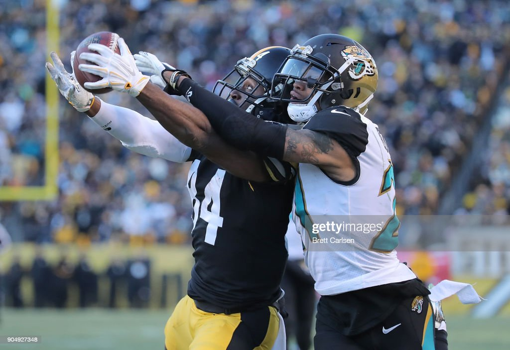 Antonio Brown #84 of the Pittsburgh Steelers makes a catch while being defended by A.J. Bouye #21 of the Jacksonville Jaguars for a 43 yard touchdown reception in the fourth quarter AFC Divisional Playoff game at Heinz Field on January 14, 2018 in Pittsburgh, Pennsylvania.