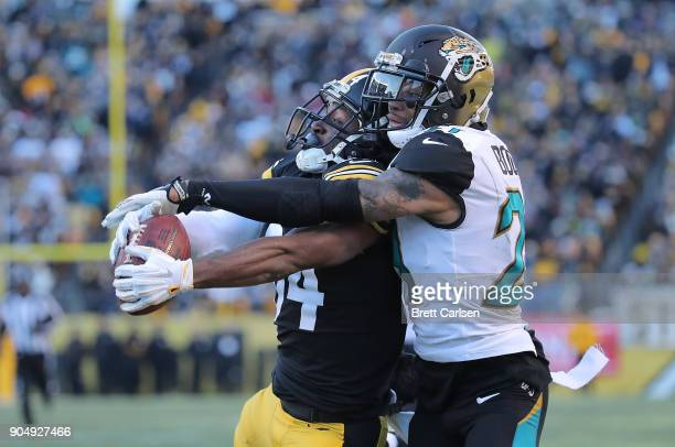 Antonio Brown of the Pittsburgh Steelers makes a catch while being defended by AJ Bouye of the Jacksonville Jaguars for a 43 yard touchdown reception...