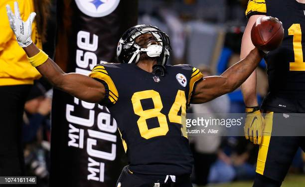 Antonio Brown of the Pittsburgh Steelers reacts after a 17 yard touchdown reception in the first quarter during the game against the New England...