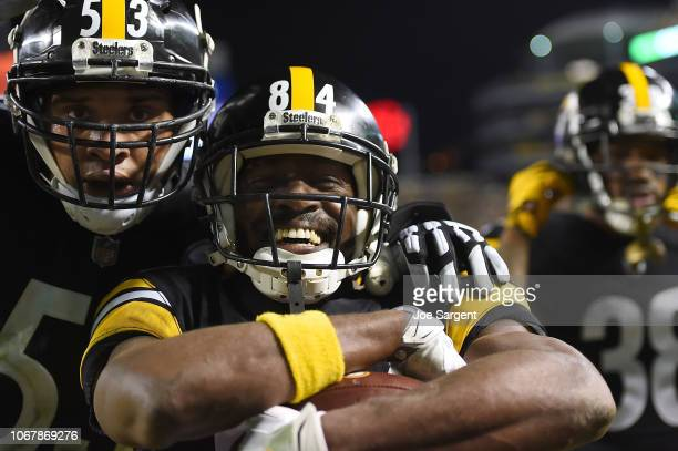 Antonio Brown of the Pittsburgh Steelers reacts with Maurkice Pouncey after a 28 yard touchdown reception in the second quarter during the game...