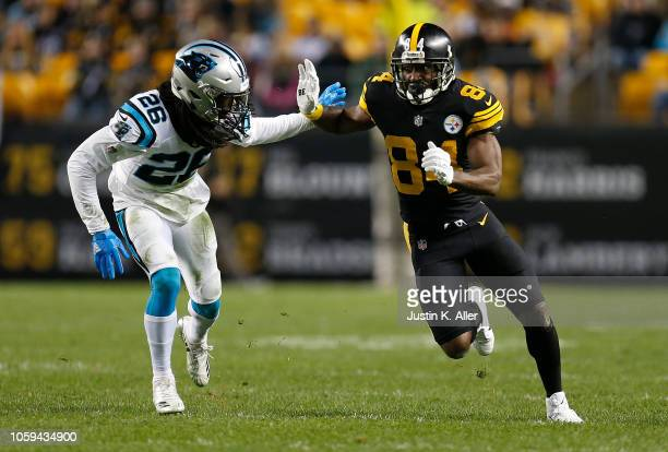 Antonio Brown of the Pittsburgh Steelers runs a route as Donte Jackson of the Carolina Panthers defends during the first half in the game at Heinz...