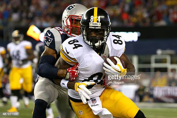 Antonio Brown of the Pittsburgh Steelers runs after a catch against Malcolm Butler of the New England Patriots in the first half at Gillette Stadium...