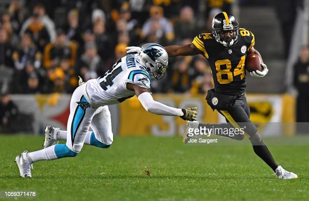 Antonio Brown of the Pittsburgh Steelers runs up field as James Bradberry of the Carolina Panthers attempts a tackle during the first half in the...