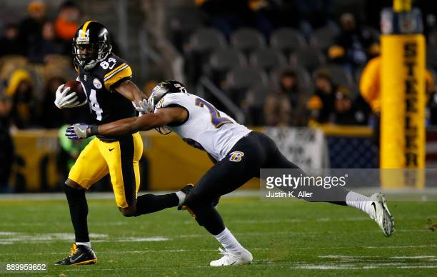 Antonio Brown of the Pittsburgh Steelers runs upfield after a catch in the third quarter during the game against the Baltimore Ravens at Heinz Field...
