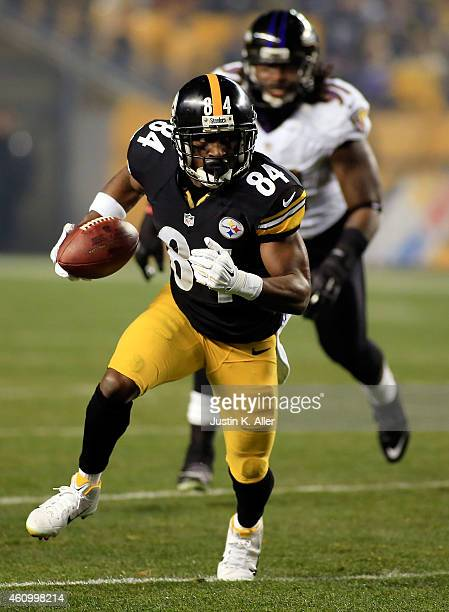 Antonio Brown of the Pittsburgh Steelers runs with the ball in the first quarter against the Baltimore Ravens during their AFC Wild Card game at...