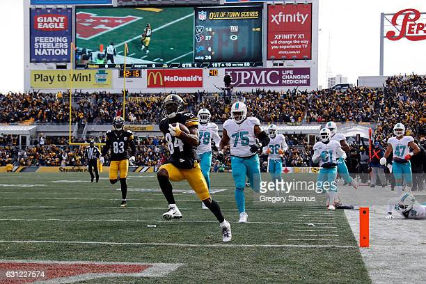 Antonio Brown of the Pittsburgh Steelers scores a touchdown after catching a pass from Ben Roethlisberger against the Miami Dolphins in the AFC Wild...