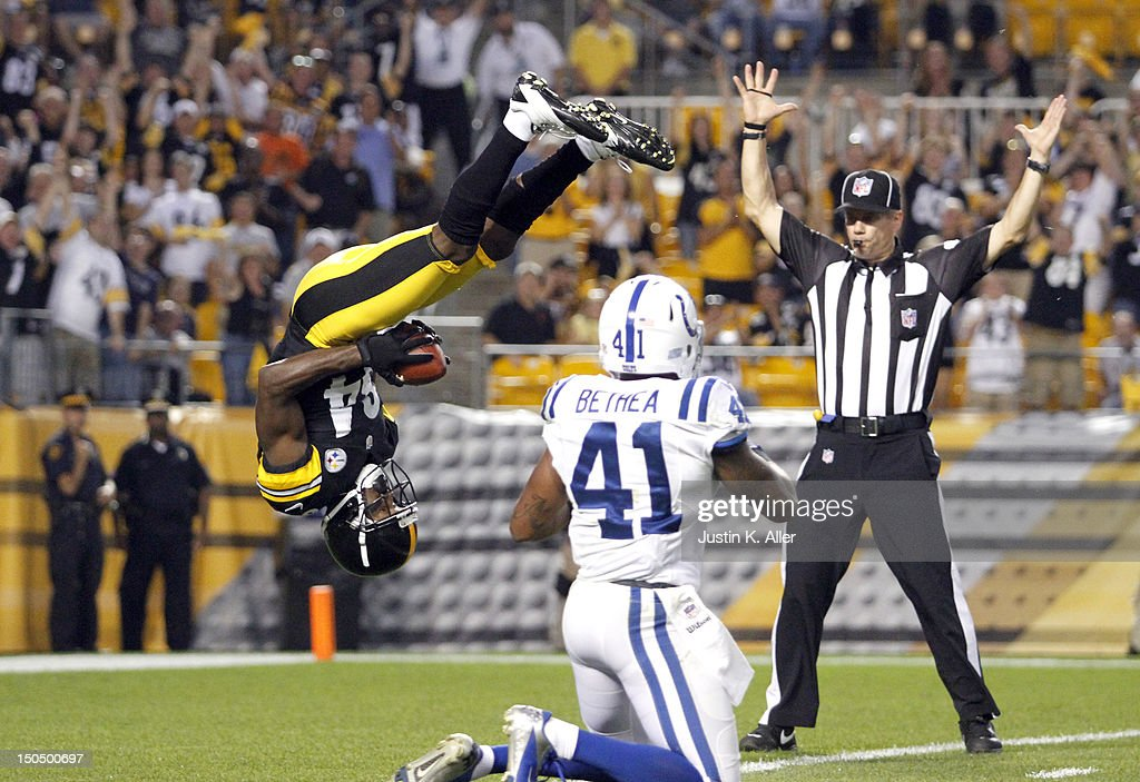 Antonio Brown #84 of the Pittsburgh Steelers scores a touchdown on Antoine Bethea #41 of the Indianapolis Colts in the first quarter during the game on August 19, 2012 at Heinz Field in Pittsburgh, Pennsylvania.