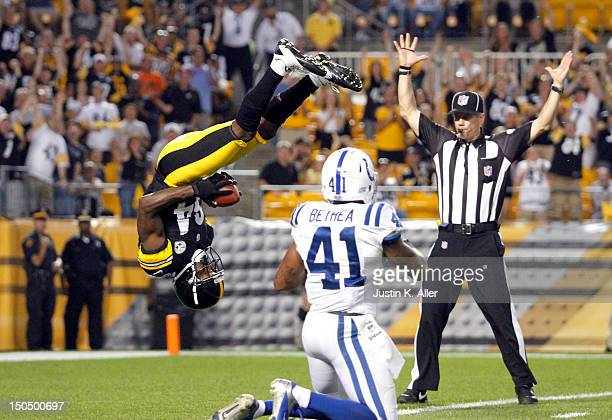 Antonio Brown of the Pittsburgh Steelers scores a touchdown on Antoine Bethea of the Indianapolis Colts in the first quarter during the game on...