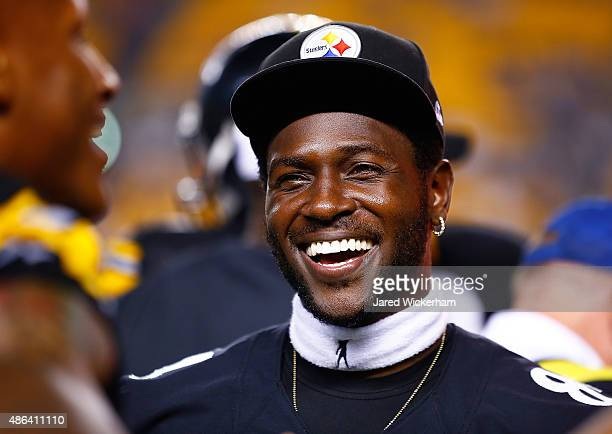 Antonio Brown of the Pittsburgh Steelers shares a laugh on the sideline in the second half against the Carolina Panthers during the game at Heinz...