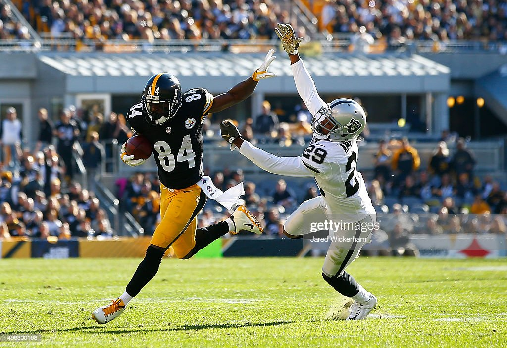 Antonio Brown #84 of the Pittsburgh Steelers sheds David Amerson #29 of the Oakland Raiders in the first half of the game at Heinz Field on November 8, 2015 in Pittsburgh, Pennsylvania.
