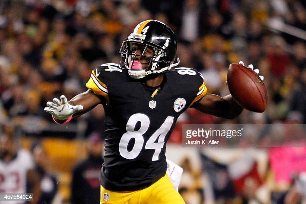 Antonio Brown of the Pittsburgh Steelers throws a touchdown pass to Lance Moore in the second quarter against the Houston Texans during their game at...