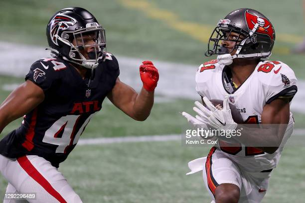 Antonio Brown of the Tampa Bay Buccaneers catches a 46 yard pass to score a touchdown against Tyler Hall of the Atlanta Falcons during the fourth...