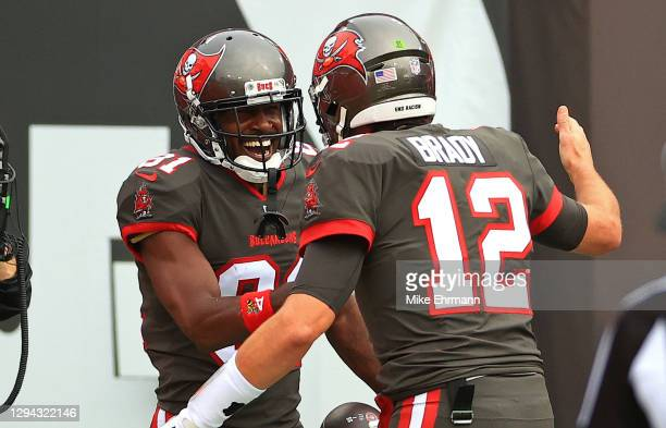 Antonio Brown of the Tampa Bay Buccaneers celebrates a touchdown with Tom Brady during a game against the Atlanta Falcons at Raymond James Stadium on...
