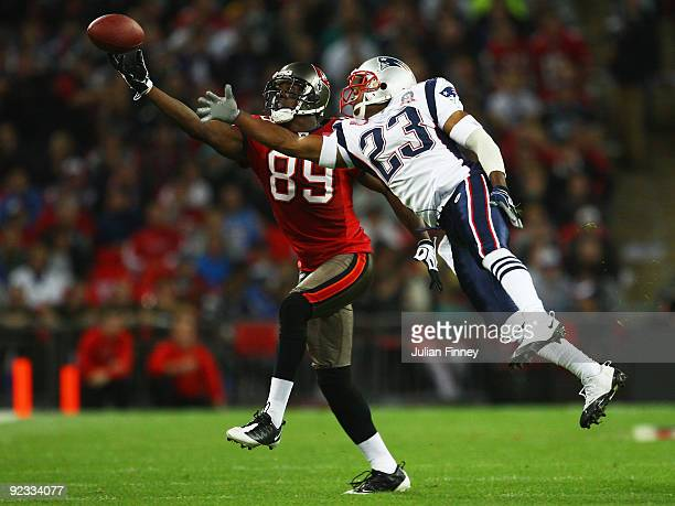 Antonio Bryant of Tampa Bay Buccaneers and Leigh Bodden of the New England Patriots compete for the ball during the NFL International Series match...